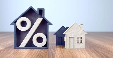 Houten huizen met een procentteken